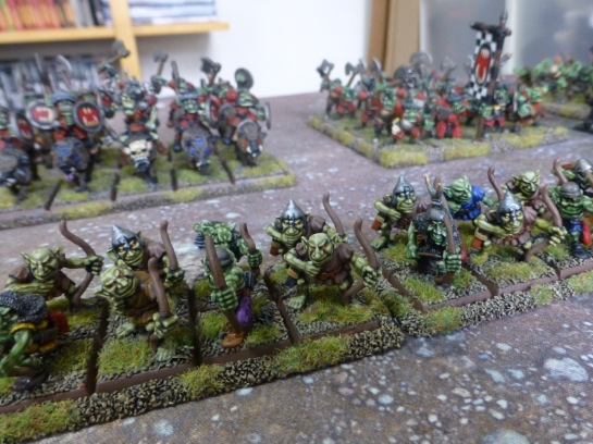 A line of goblins in front of orc regiments
