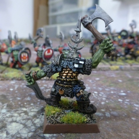 Back view of the Orc Hero wielding sword and axe