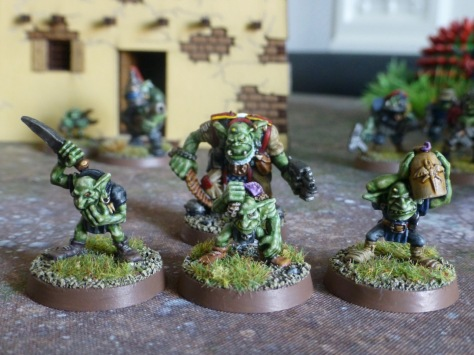 Three Gretchin with squig hunting utensils