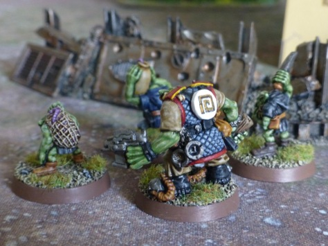 Back view of a Blood Axe Runtherd and Grot assistants