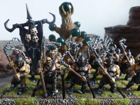 Horde of burly back-clad barbarians wielding two-handed iron chain flails