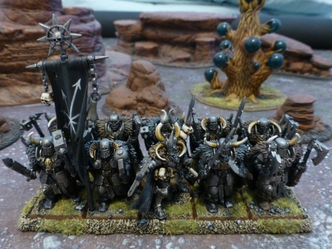 Two ranks of warriors clad in heavy steel armour