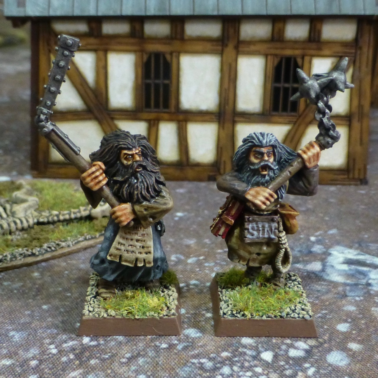 Two flagellants with double handed flails