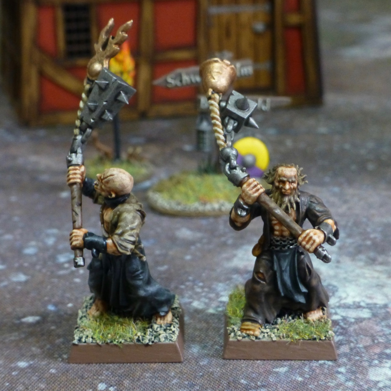 Two flagellants with bronze and iron flails
