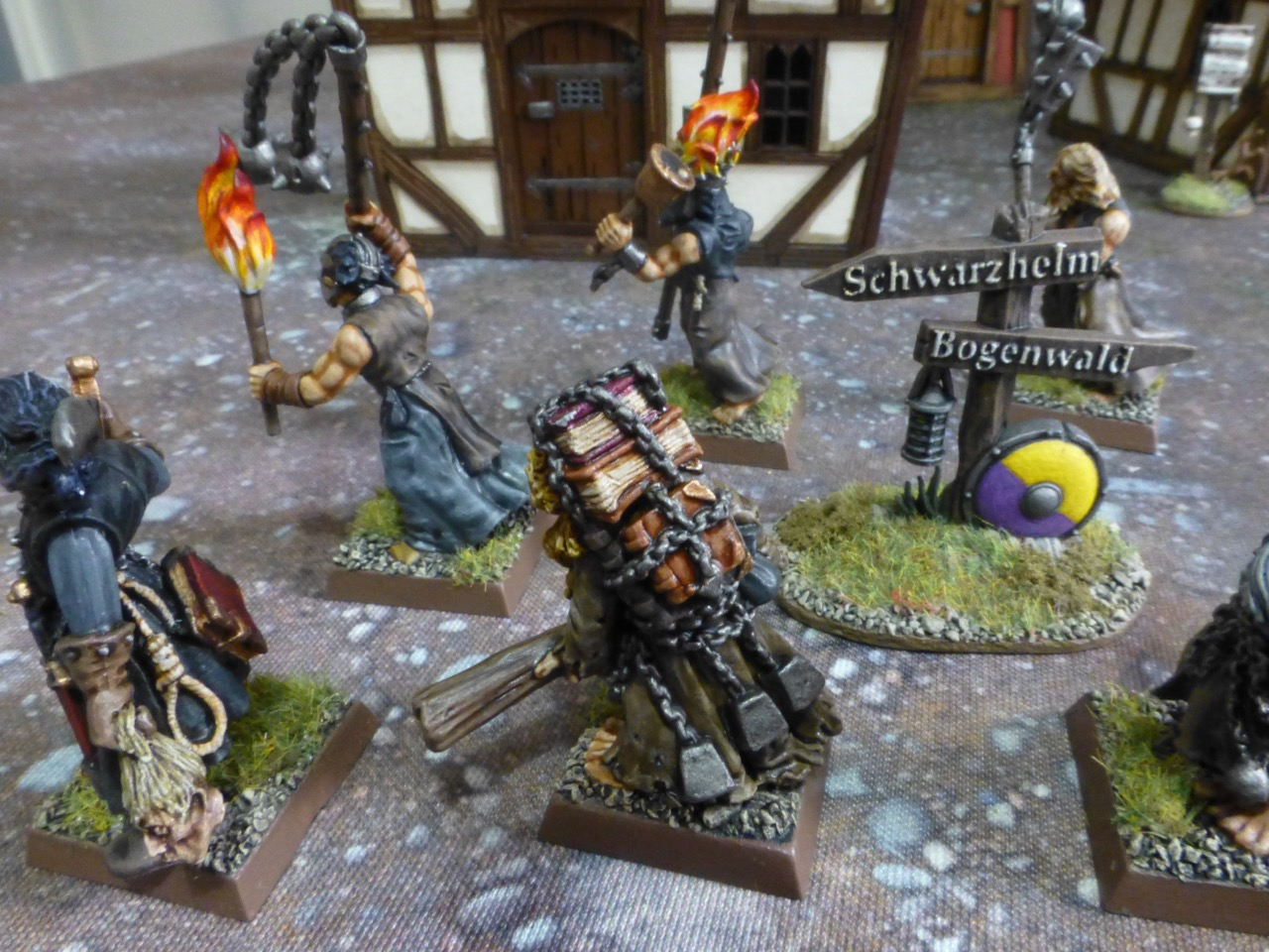 Back view of warband next to a road sign