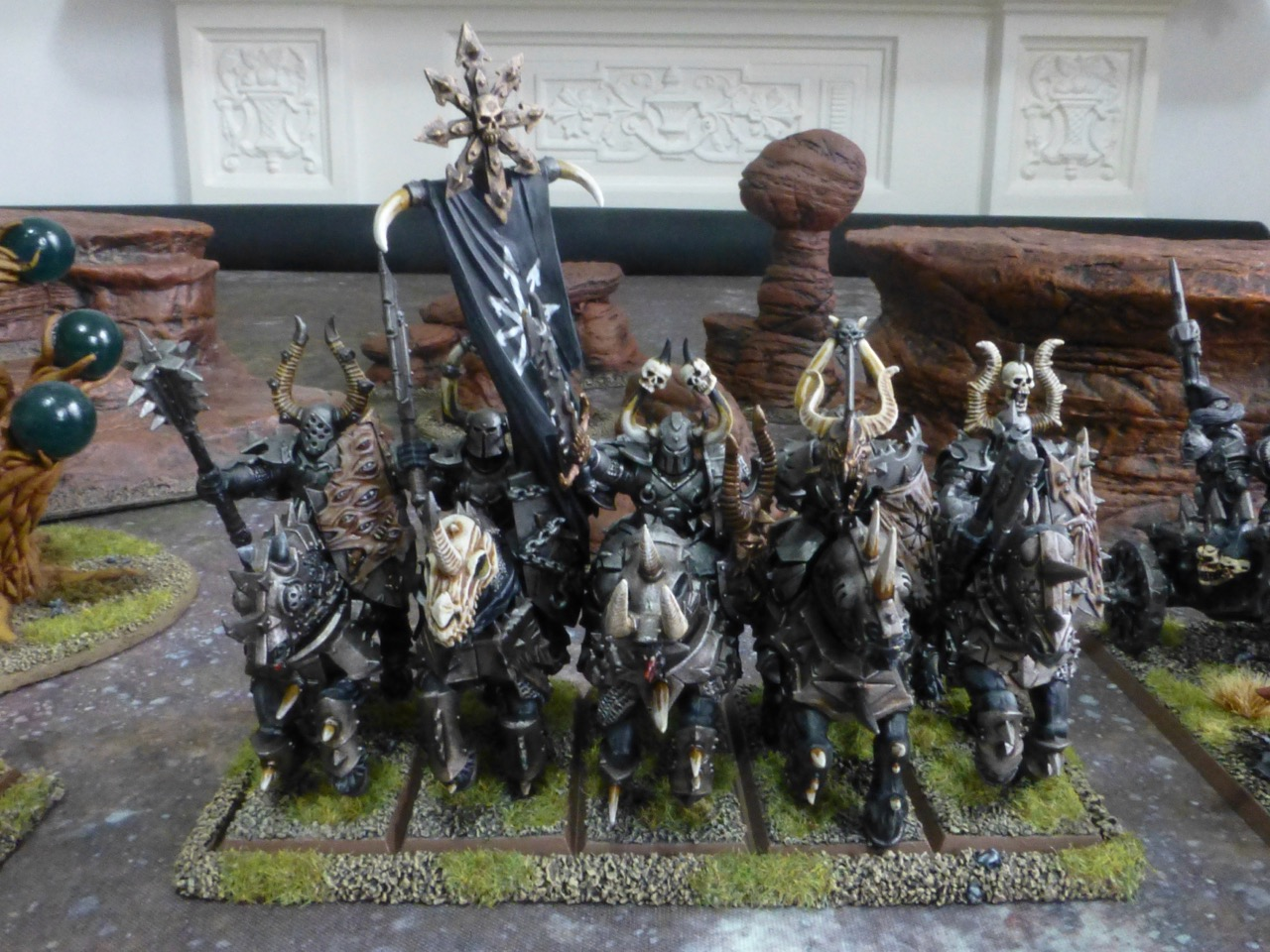 Five armoured riders on barded black horses