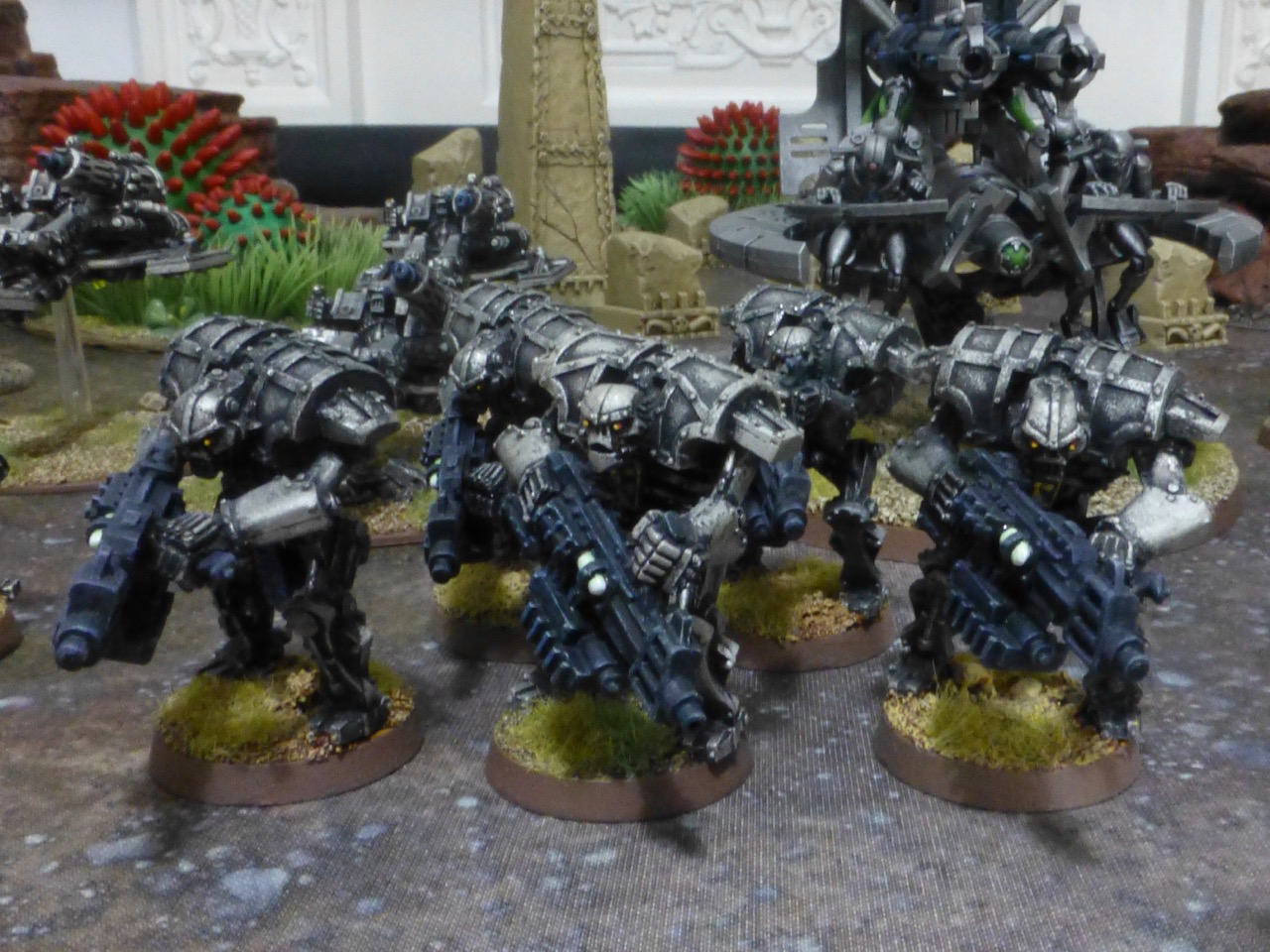 Bulky robotic warriors carrying heavy guns
