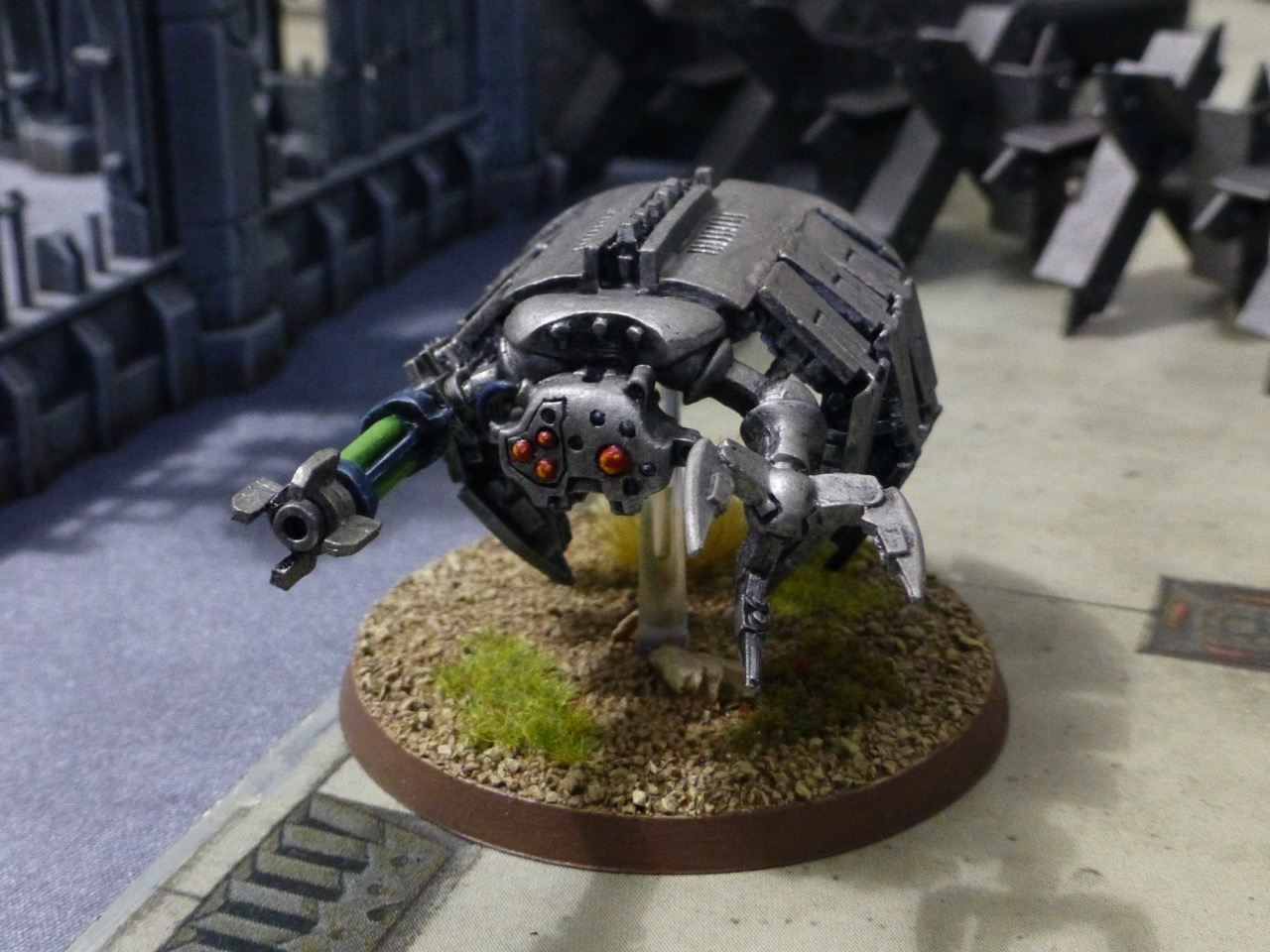 Floating beetle-like robotic construct with a rending claw and long gun