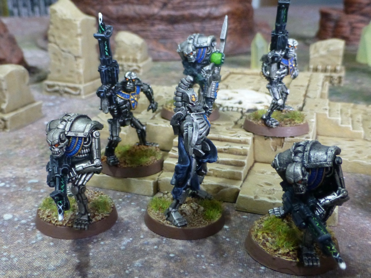 Necron Lord gesturing a group of robotic warriors forwards