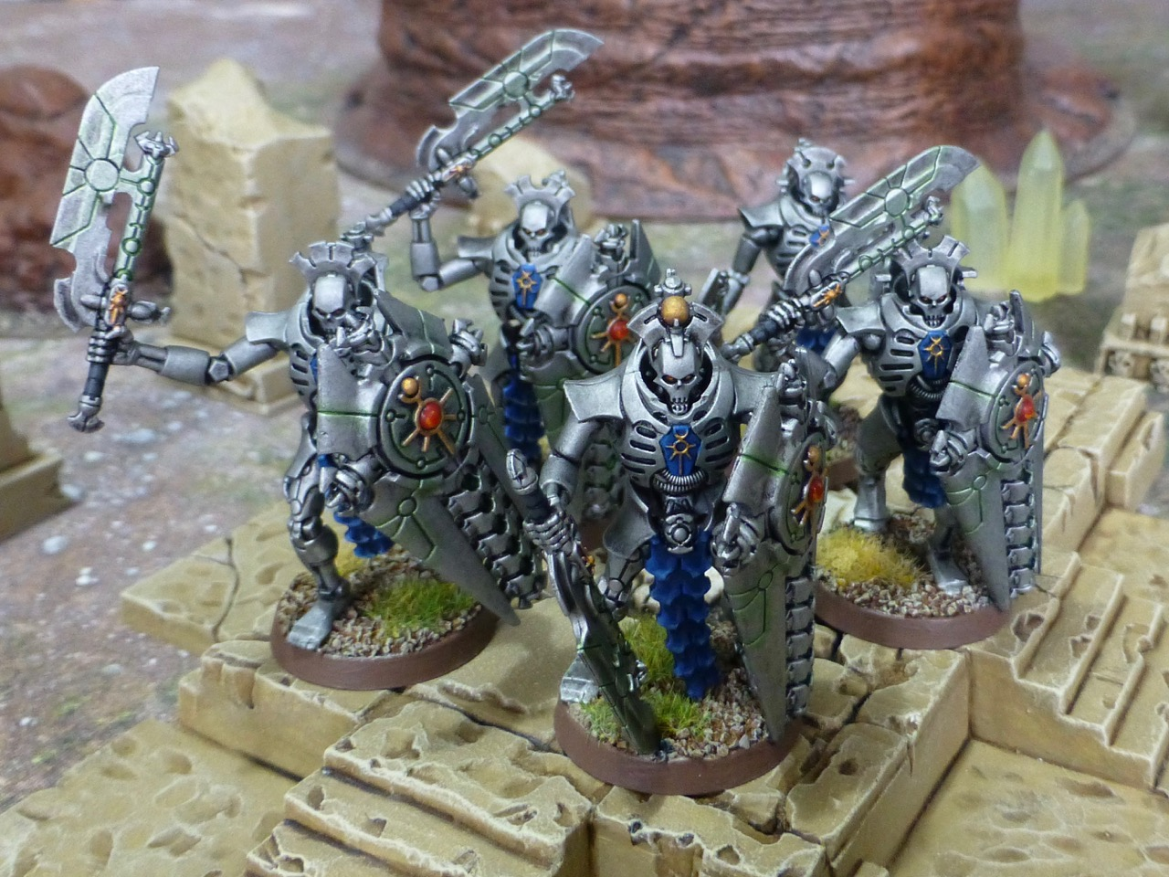Group of robotic warriors with large shields and swords