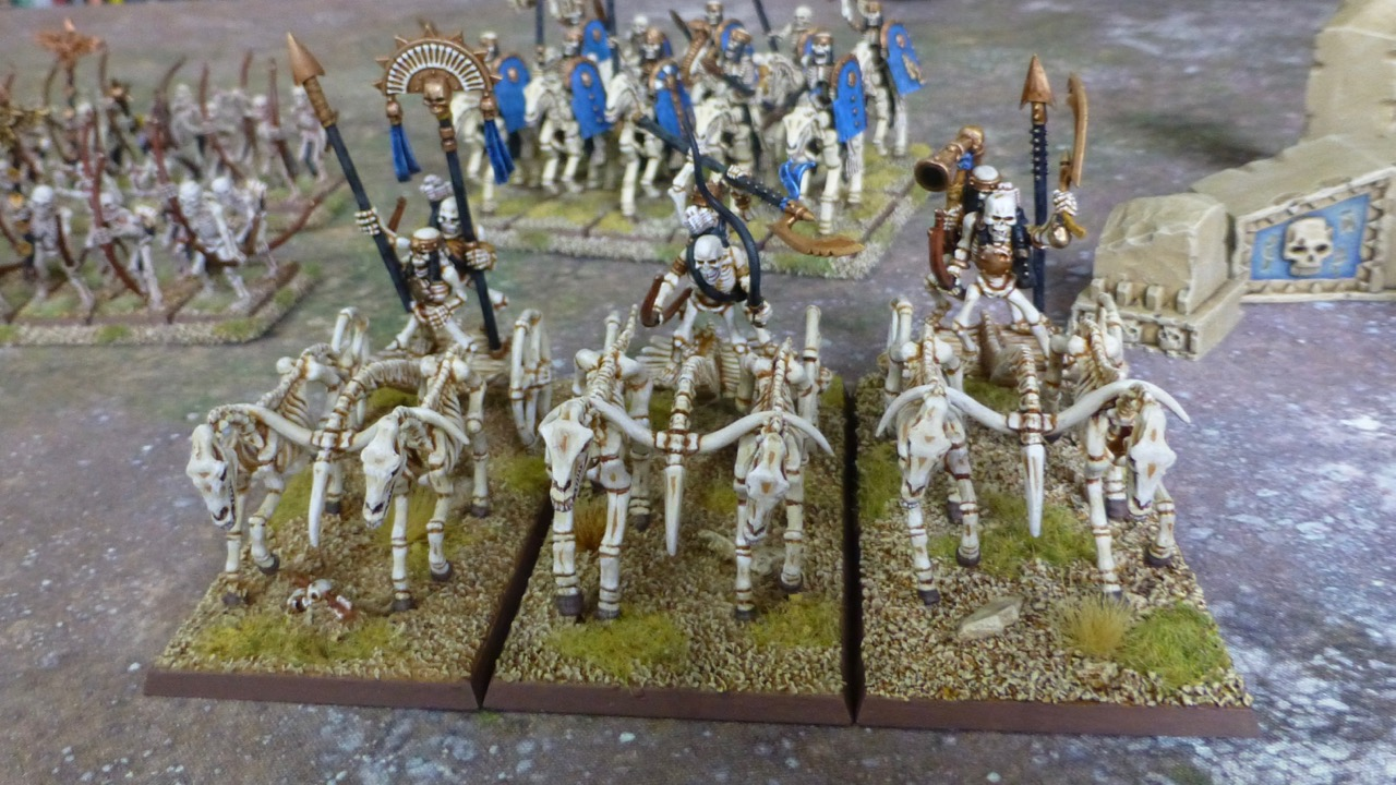 Three chariots made of bones pulled by skeletal horses