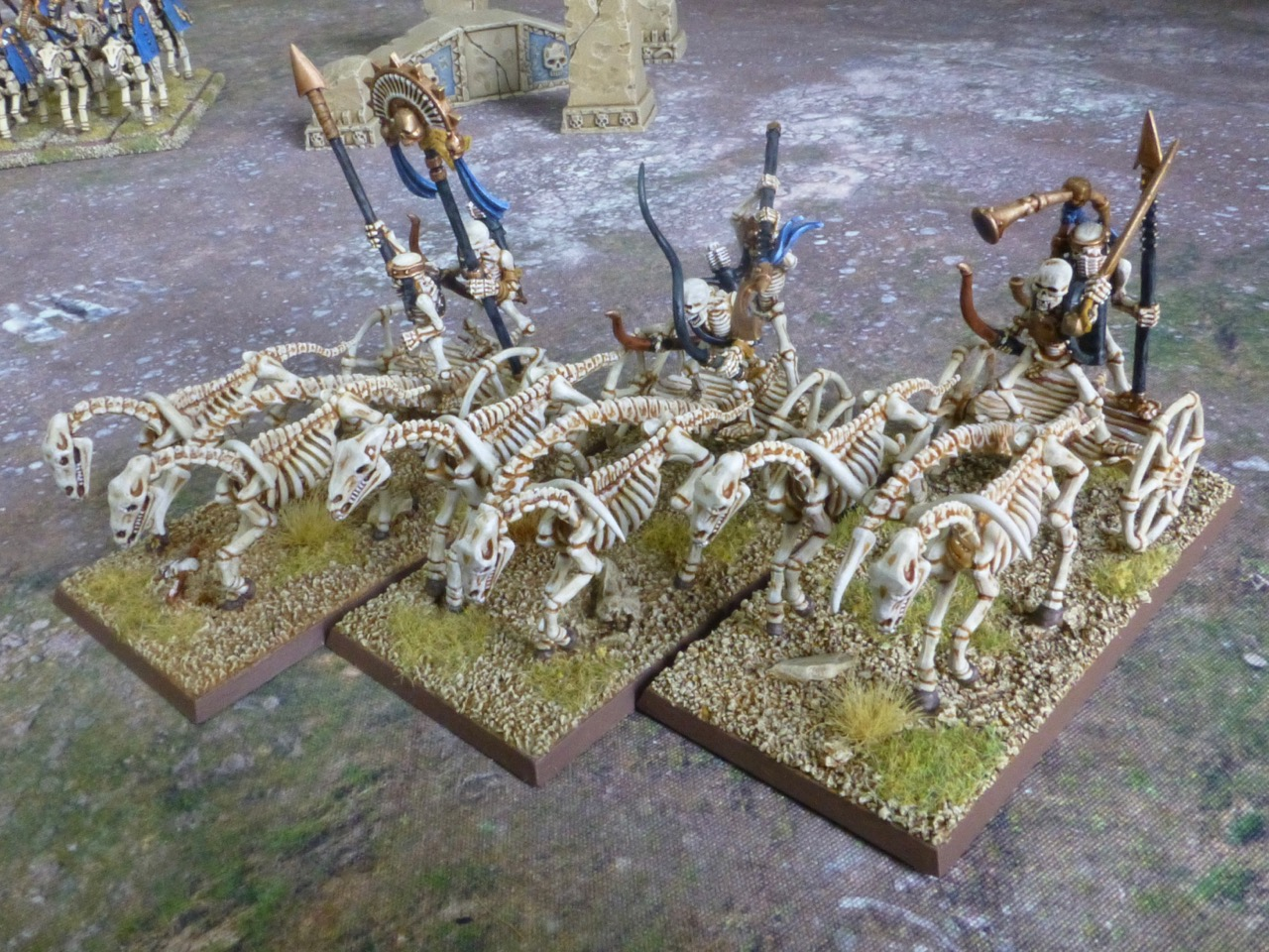 There skeleton chariots driving in line