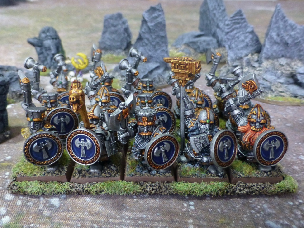 Three ranks of Dwarf warriors in full plate armour