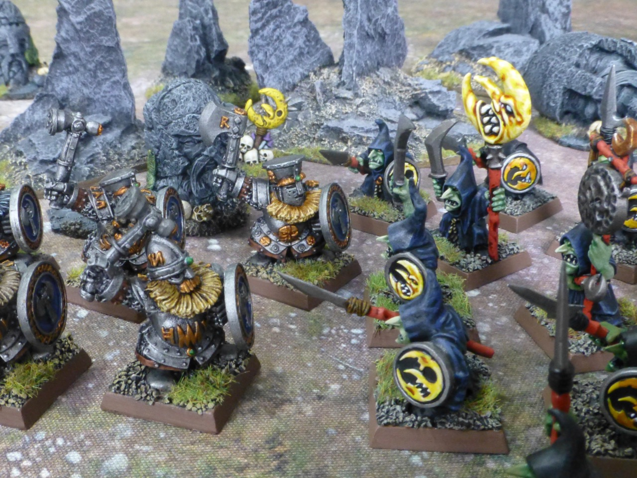 Dwarf Ironbreakers in loose formation clashing with Night Goblins in black cloaks