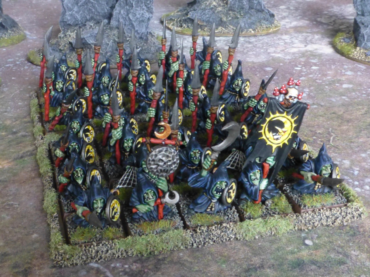 Large block of goblin infantry in black robes, carrying spears and shields