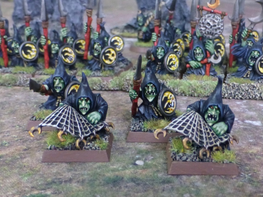 Small group of goblins carrying either nets or spears