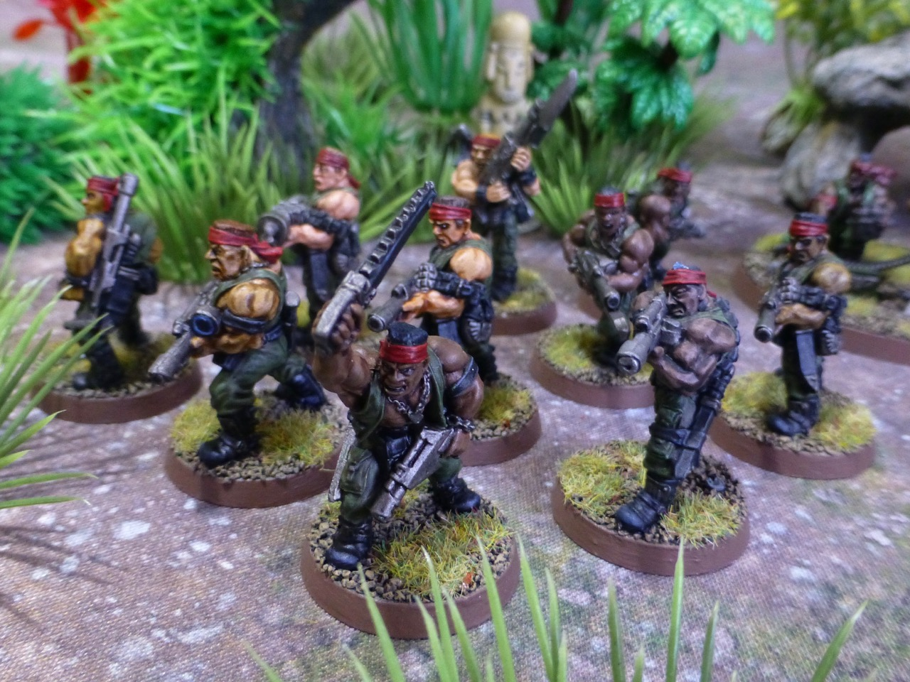 A unit of troopers lead by a sergeant wielding a chainsword