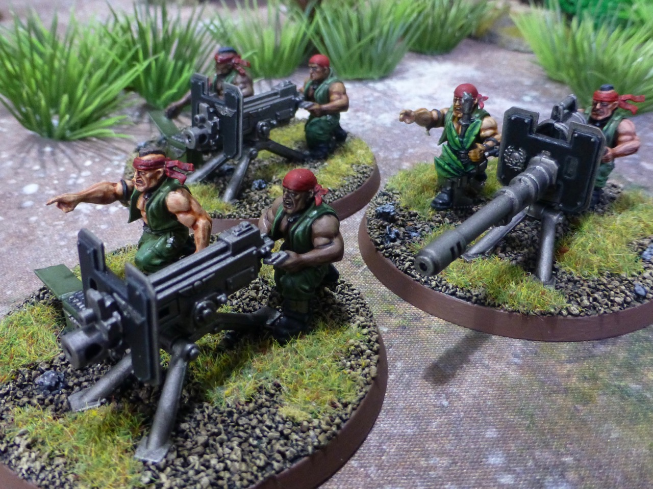 Three teams equipped with heavy guns on tripods