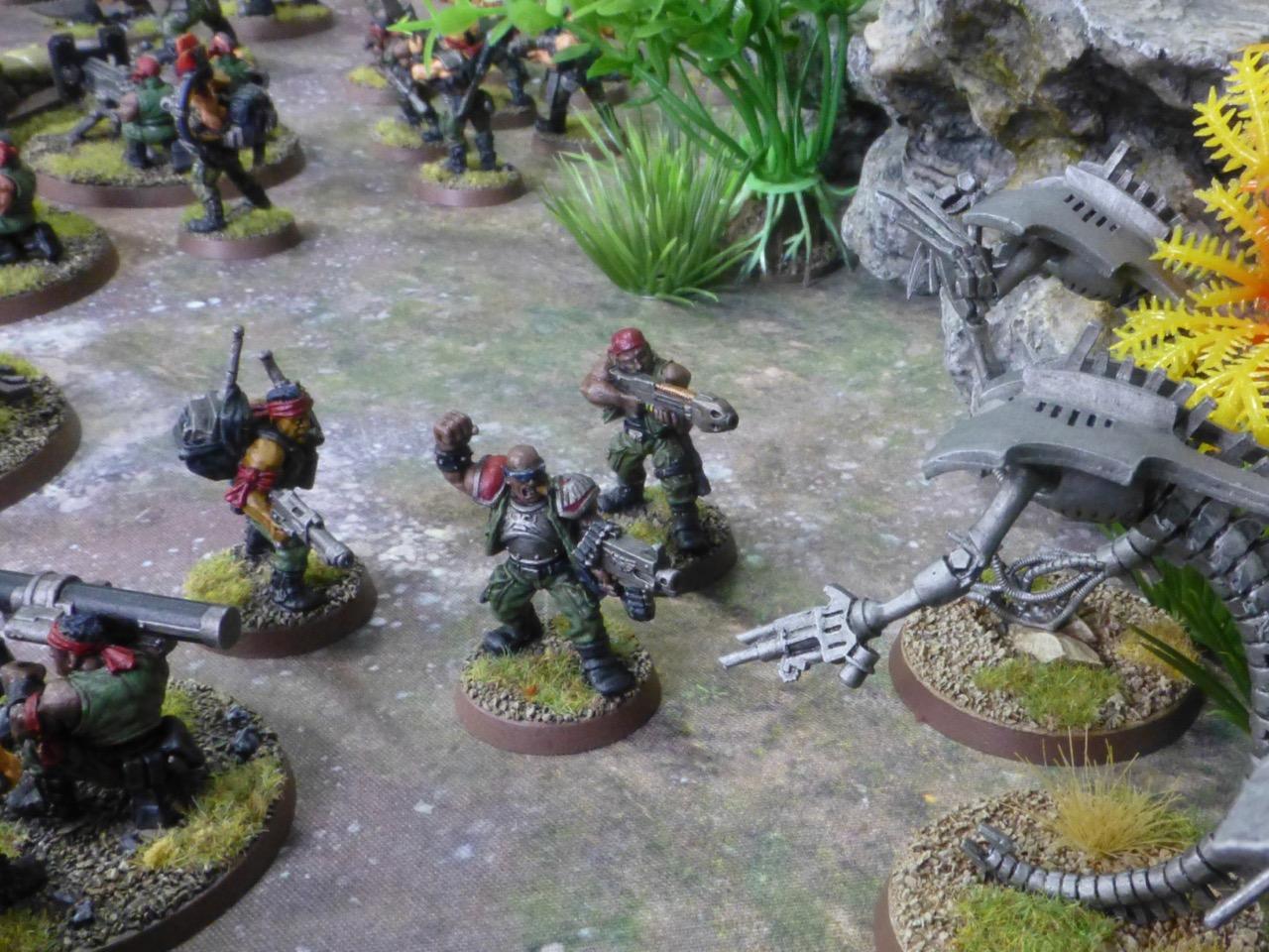 Battle scene between Necrons and Catachan Jungle Fighters
