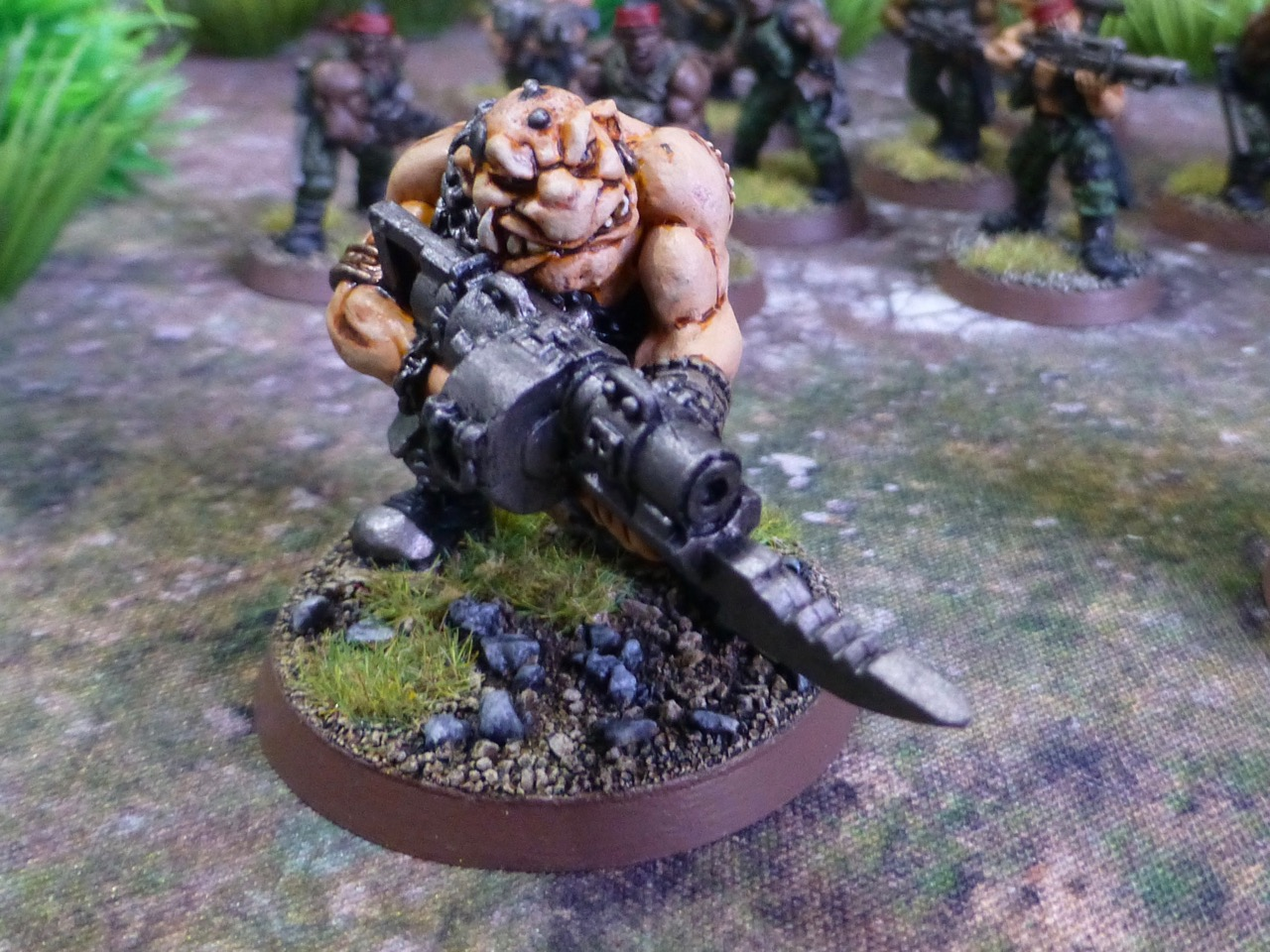 Ogryn holding a gun with attached bayonet